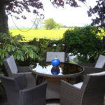 A garden with a view of rural Rixton-with-Glazebrook - 2012.