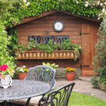 A Swiss Chalet garden shed is the main feature in this small garden - 2018.