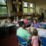 Visitors enjoying some home-made fayre at Rixton Methodist Church - 2013.