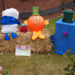 Some of the colurful Mr Men scarecrows in the 2018 Garden Safari - Mr Bump, Mr Small, Mr Clever and Mr Grumpy.