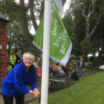 Chair of the Friends group raises the 2017-2018 Green Flag, making it the 6th year on the run - July 2017.