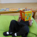 Comfy spaces and a range of books provide for a bit of quiet reading-time.