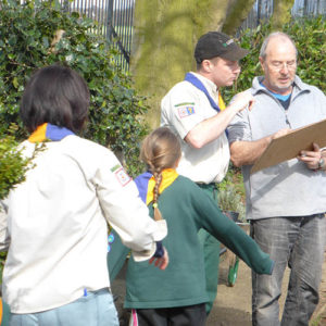 Friends volunteer discussing plans with Cubs for the Cubs Remembrance Garden.