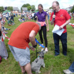 Marvin proudly accepts his rosette for winning second prize in the dog competition - Carnival 2015.