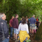 The Claypits Ranger tells visitors about the different varieties of trees and shrubs flourishing in the woodland.