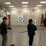 Cubs try their hand at archery.
