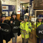 Cubs trying on Police uniforms at the Warrington Police Museum - 2018.
