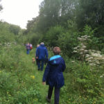 Walkers enjoying a stroll through Rixton Claypits Nature Reserve - a Site of Special Scientific Interest (SSSI)