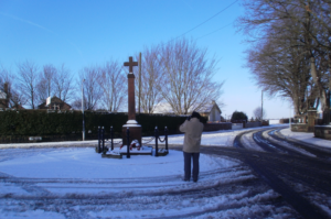 Winter scene of the Cenotaph in Hollins Green January 2013.