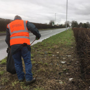 Community Plan Litter Pick volunteer tackles litter along the A57 Hollins Green - February 2019