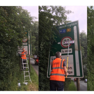 Community Plan volunteer cleans the Warburton Bridge sign - action day 1st June 2019.